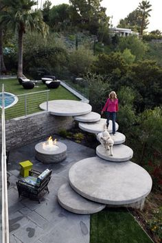 Floating steps head down to a back-patio fire pit.