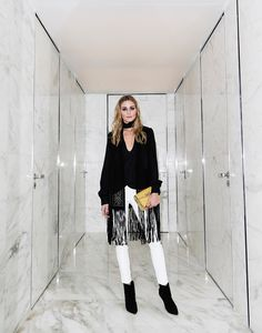 "Snapped: Black and White ""Hey everyone!  Here I am in Paris keeping things neutral in a pair of white Daryl K leather leggings, a black Zara blouse with fringe overlay and suede pointed toe Dior booties. For a pop of color I wore a studded mustard yellow Valentino bag.""  OP"