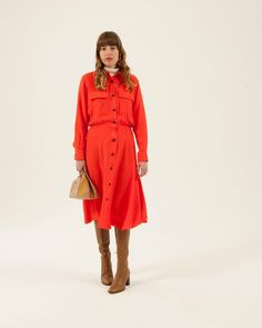 white polo neck Uniqlo, red shirt dress with black buttons Warehouse, brown knee length boots L K Bennett, red and gold dangly earrings Milk Tooth London