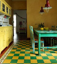Yellow and green kitchen  Maybe we could paint the concrete in our red, black and yellow super casual dining room?!