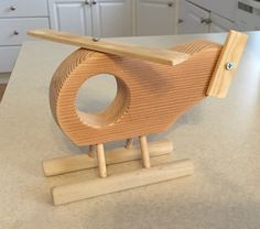 Wooden toy helicopter for my nephew that I made from fir, pine, and poplar…