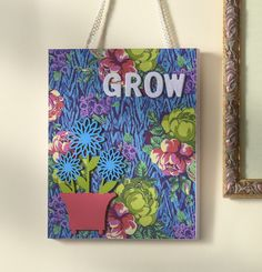 """Use Amy Butler's pretty papers and your favorite decoupage medium to make this easy """"Grow"""" DIY wall hanging. Instant wall art with little effort!"""