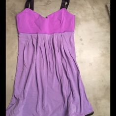 Purple Lululemon tank Adjustable straps, built in bra with a brighter purple Luon top with an adjustable tie at the bottom. Size 4. Great Conditional!! lululemon athletica Tops Tank Tops
