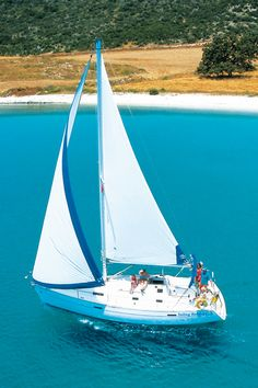 Our Beneteau 331 with in mast furling...sailing past the Greek Mainland