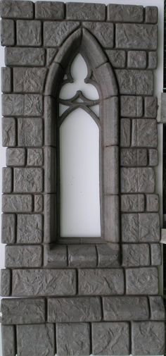 You can have a castle window just like Maleficent with this Cathedral Wall with Narrow Gothic Window from HauntedProps.com