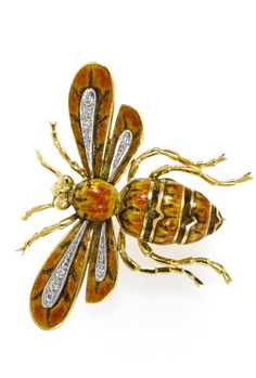 A enamel and diamond insect brooch of bee; gross weight approximately: 30.5 grams; mounted in eighteen karat gold.