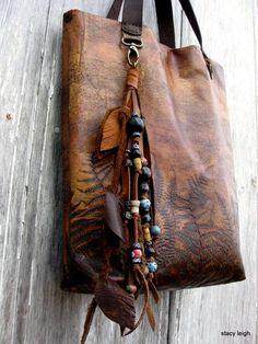 Carved shoulder bag.