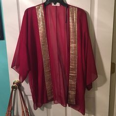 Burgundy cover up Light burgundy cover up. I ordered if off line new without the tag Stylebook Tops