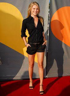 Black shirt and black shorts with heels