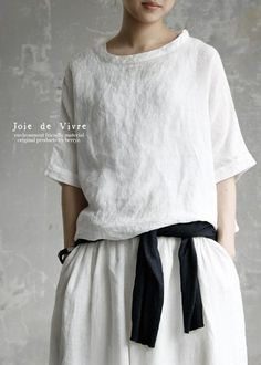 Summer linen oversized relaxed look in white skirt and round neckline top