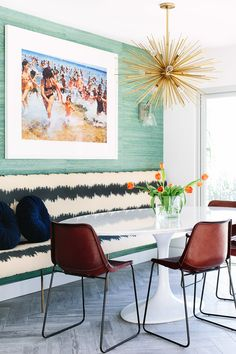 Dining room, breakfast nook, sputnik chandelier, leather chairs, framed artwork,