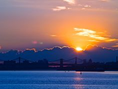 Sun comes up behind the clouds with the Brooklyn and Manhattan Bridges in front 7.10.13