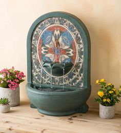 Make your home feel like an open-air hacienda when you display this handsome Indoor/Outdoor Fountain with Mosaic Front. Designed for use indoors or out, the sound of water will soothe your mind while the handsome mosaic decorates your wall. Cast in sturdy but light glass-reinforced cement, this handsome fountain is painted in a teal finish with a painted mosaic in complementary colors. Water pours from three spouts into the basin below and is recirculated thanks to the quiet electric p Outdoor Walls, Indoor Outdoor, Outdoor Water Features, Mosaic Designs, All Wall, Cement, Basin, Wall Art Decor, Accent Decor