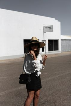 DEAN STREET | Fiona from thedashingrider.com wears a white White Zara Blouse, a Black Studded Leather Skirt from Ikks, a Straw Hat from Catarzi and a Vintage Chanel Bag #ootd #whatiwore #petite #texas #marfa