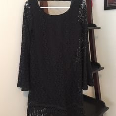 Forever 21 bell-sleeve dress, size small Cute Forever 21 boho bell-sleeve dress, black, size small. Got so many compliments on this! In good condition, with the exception of a hole (in picture 3). Fits true to size and is lined. Price reflects condition. Forever 21 Dresses