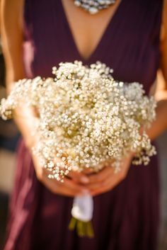 Simple, beautiful baby's breath bouquets for bridesmaids from Alex & Jim's small budget, DIY rustic meets modern Northern Virginia wedding. Images by Stephen Gosling Photography.