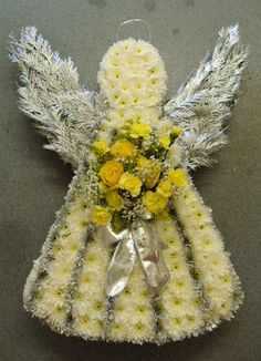 Angel with silver wings and yellow posy arrangement Funeral Floral Arrangements, Unique Flower Arrangements, Unique Flowers, Silk Flowers, Flower Wreath Funeral, Funeral Flowers, Flower Spray, Flower Bird, Cemetary Decorations