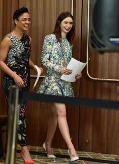 Lily Collins Photos - Actors Tessa Thompson (L) and Lily Collins walk onstage during the Film Independent 2018 Spirit Awards press conference at The Jeremy Hotel on November 21, 2017 in West Hollywood, California. - Film Independent 2018 Spirit Awards Nominations Press Conference