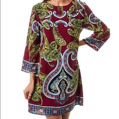 Burgundy Paisley Print Dress Burgundy | Round Neck | 1/2 Sleeve paisley tile print dress featuring a back keyhole with bottom. A classic dress with a twist! 100% Polyester. I have sizes: Small, Medium and Large.  Ships free on boutique. Dresses Long Sleeve