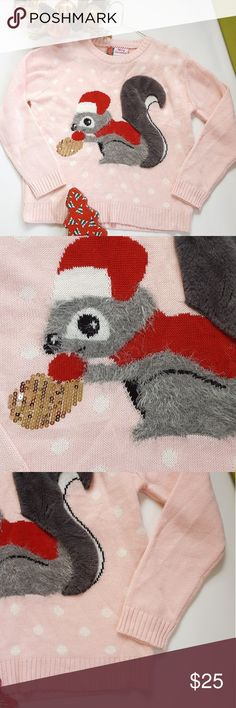 Christmas Sweater with Squirrel Sparkle Nut Fantastic sweater from Merry Christmas. This has awesome white polka dots on a pink background. Christmas scene is a fuzzy grey squirrel wearing a Christmas Santa hat with a glittery gold nut and furry tale. Perfect for white elephant or holiday party!!! Size Med. Merry Christmas Sweaters