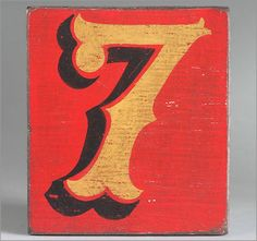 Hand-painted wooden sign: fairground number '7'