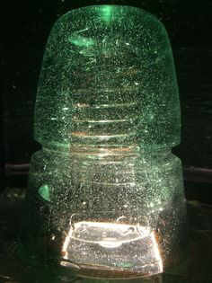 This is my cd 145 H.G.Co. Glass insulator in lime green. It has a squared off dome and has many bubbles.  #underwaterinsulators