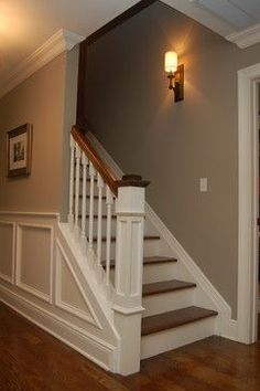 Love this staircase, and the colonial trim really enhances the look. Gorgeous Newell posts, as well... the dark wood looks great with white moulding!