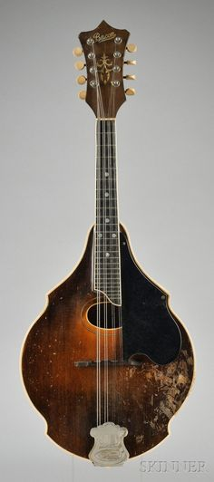 """Bacon mandolin. Everyone knows about Gibson; most people know about Lyon & Healy; but fewer people recall that the Bacon Banjo Company of Groton, Ct., also competed in the carved mandolin market, at least for a brief time. With their own aesthetic and a good sound, these rare mandolins are of interest to both collectors and players. They were endorsed by classical player/teacher William Place Jr., making them the first """"signature-label"""" carved mandolins.  Examples include the…"""