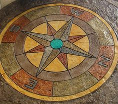 Beautiful stamped compass rose on a concrete patio
