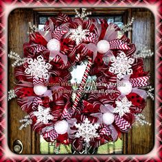My 2013 Mega 32 inch custom christmas candy canes snowflakes red and white deco mesh wreath I made for my door decor!! Custom wreaths by bethany arriola
