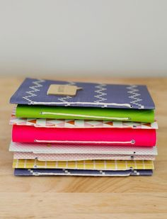 """You guys, I made all these journals in, like, an hour! I've made journals before, but this is the simplest way I've found to create a little collection in no time at all. These little guys make great gifts, and I love that it's easy to build up a stash. Here's how: Supplies: -regular 8.5 """"x 11"""" printer paper (you need about 7 sheets per journal) -Crop-A-Dile punch tool -string..."""