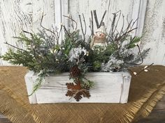 A personal favorite from my Etsy shop https://www.etsy.com/listing/613693067/a-primitive-wood-box-winter-snowman