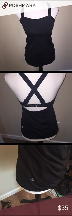 Lululemon small built in bra black work out top Lululemon small work out top .  Great condition! lululemon athletica Tops Tank Tops
