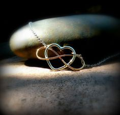 heart and infinity silver and gold necklace by DesignsByDomino