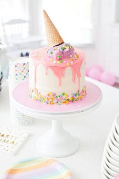"""Ice Cream Social Birthday Party with DIY Ice Cream Balloons, and ice cream cone """"spilled"""" cake, Ice Cream bar with cookies for DIY ice cream cookie sandwich bar and more! So much sweetness for a sweet first birthday party!"""