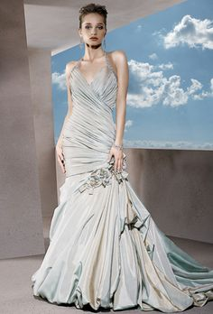 Brides: Demetrios - Sensualle. Taffeta ruched V-neck halter dress with beaded straps and lace-up back. Fit-and-flare skirt features side bustle, flowers and bubble hem.