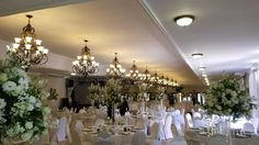 Square Tables, Event Management, Color Pallets, Flower Decorations, White Flowers, Wedding Planner, Table Settings, Chandelier, Ceiling Lights