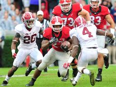 Georgia running back Nick Chubb (27) prepares to be hit by Alabama defensive back Eddie Jackson (4) as Georgia takes on Alabama at Sanford Stadium on Saturday, Oct. 3, 2015 in Athens, Ga.    (Richard Hamm/Staff) OnlineAthens / Athens Banner-Herald ~ Check this out too ~  RollTideWarEagle.com SEC Stories College Football #SEC #CFB #Alabama
