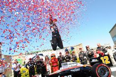 Will Power celebrates after winning the race.