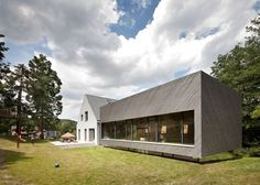 House extension by Franz Architekten clad with diagonal larch strips