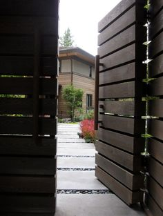 I would add some colour to these by painting one lath on each gate a bright orange or use stainless steel cladding against a matte dark brown stain or black
