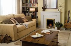 well, keep the the warmth of this room, the perfect table in the middle and why not ..the bookshelves in the corner