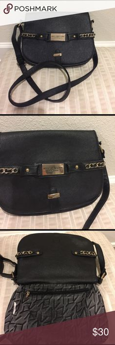 "Marc New York Nylon  with gold chain belt Marc New York Nylon with gold chain belt black cross body purse. It's in good condition however of you look at photo some of the nylon trim pealed off about 5"". And on both handles where strap is. Price reflects defects. Marc New York  Bags Crossbody Bags"