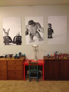 take photos of your child's favorite toys, convert picture to black and white, and then have it blown up. Great for a little boys room!