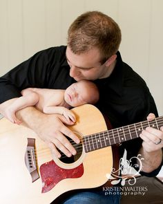 This is the father son picture I want for Adam!  Even if it's on his electric guitar!