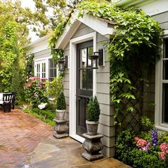 Outdoor lights and architectural details make this entryway elegant and welcoming. More ideas:  http://www.bhg.com/home-improvement/exteriors/curb-appeal/make-a-better-first-impression/?socsrc=bhgpin081213roofedentry=3