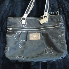 Coach poppy black bag/ tote with silver accent Preowned, worn few times. Very, clean and almost new condition. Coach Bags Totes