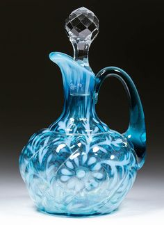 DAISY AND FERN PARIAN SWIRL MOLD CRUET, blue opalescent, applied handle and colorless cut-facet stopper. Northwood Glass Co. Late 19th/early 20th century. 6 1/2' / SOLD $259