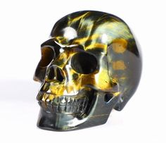 You are looking at a Blue Tiger Eye skull. The skull is inches long, from top to bottom.