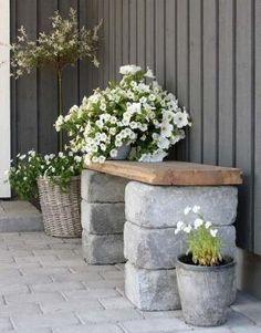 small garden bench DIY cinder blocks wood bench flower pots by gabrielle